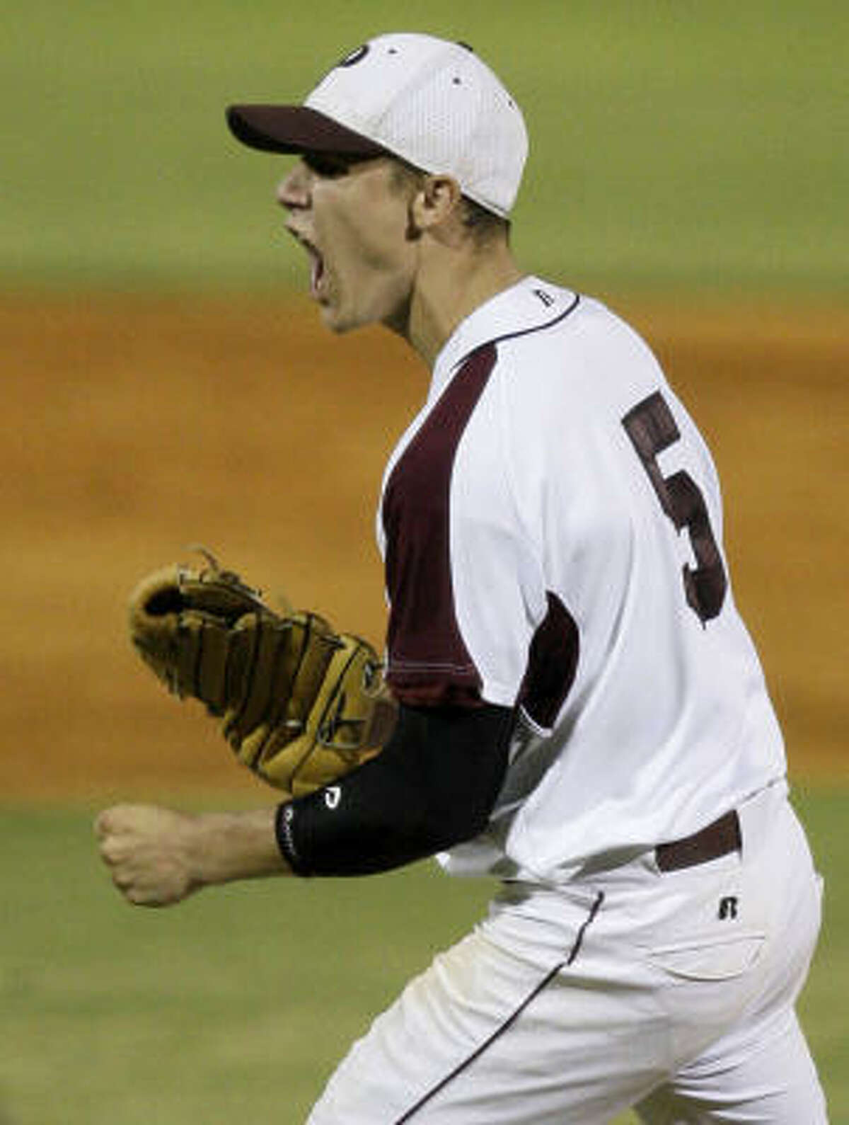 Pearland pitcher Matt Rhodes celebrates his inning-ending strike out against Brazoswood in the sixth.
