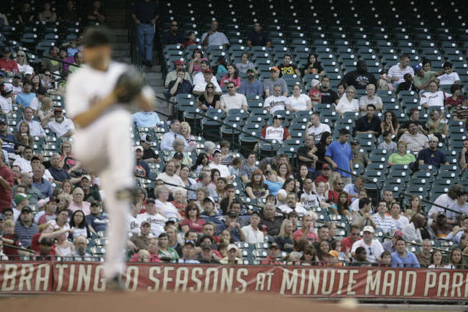 Another small crowd at Minute Maid Park saw Wandy Rodriguez give up seven runs in five innings. Photo: Billy Smith II, Houston Chronicle