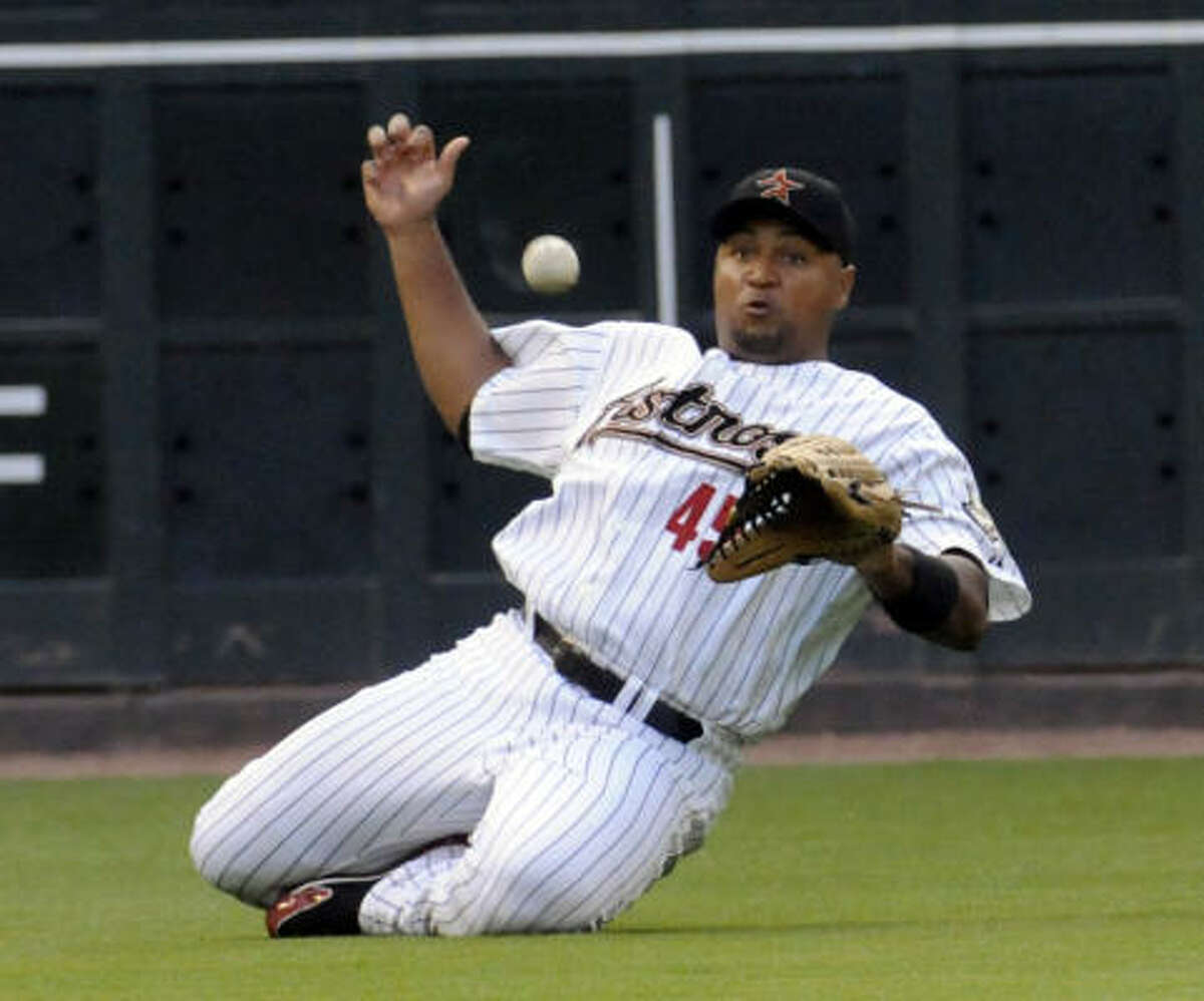 Houston's Carlos Lee is too late to make the catch, allowing Colorado's Ian Stewart a single in the second inning.