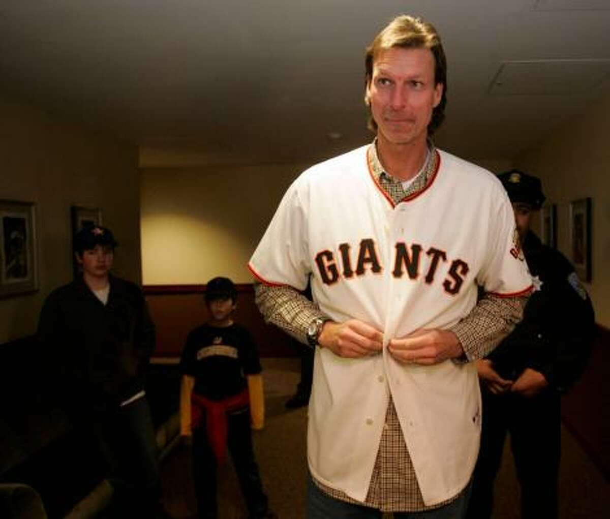 San Francisco Giants (2009) San Francisco Giants pitcher Randy Johnson tries on his new team's jersey for the first time during an open house for fans at AT&T Park in San Francisco.