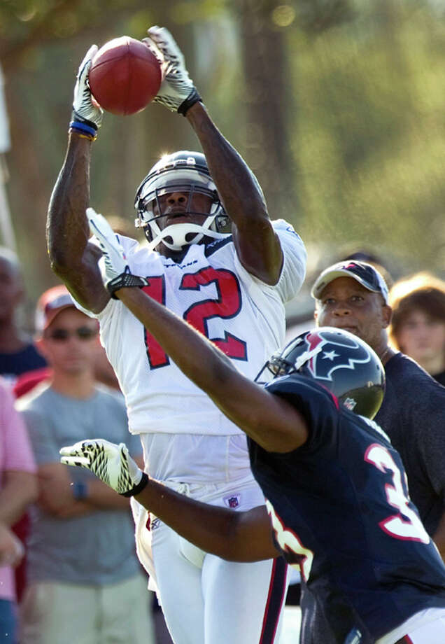 Houston Texans wide receiver Jacoby Jones (12) leaps over safety Troy Nolan (33) to make a catch during NFL football training camp Saturday, Aug. 6, 2011, in Houston. Photo: Brett Coomer/Houston Chronicle / © 2010 Houston Chronicle