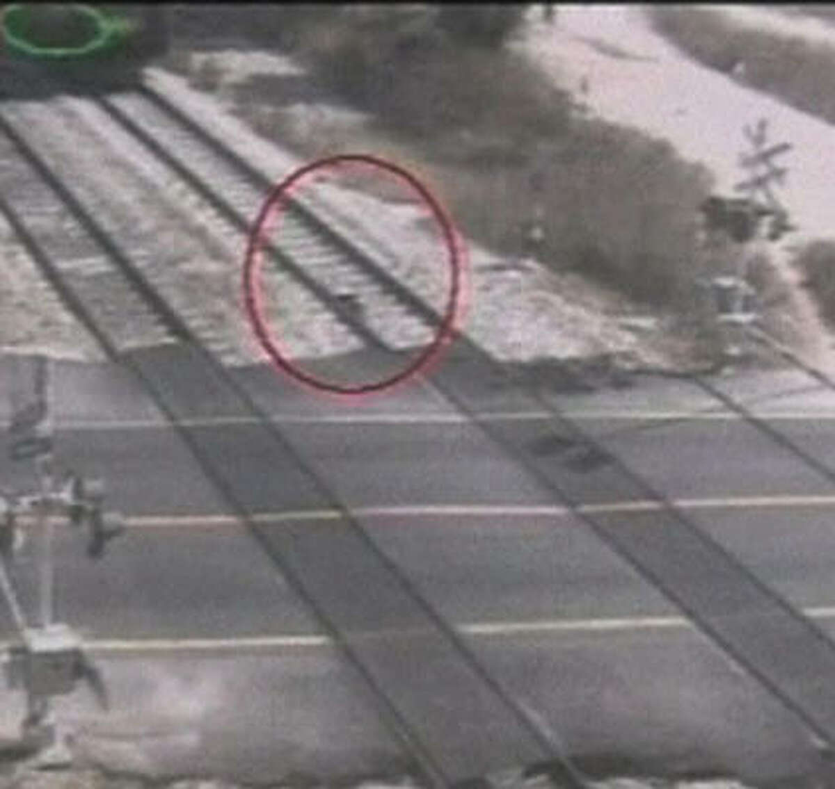 The woman puts herself on the tracks, and at the top the train appears to come into the frame. Police spokesman Micky Rosenfeld speculated that the woman was attempting suicide or was mentally unbalanced.