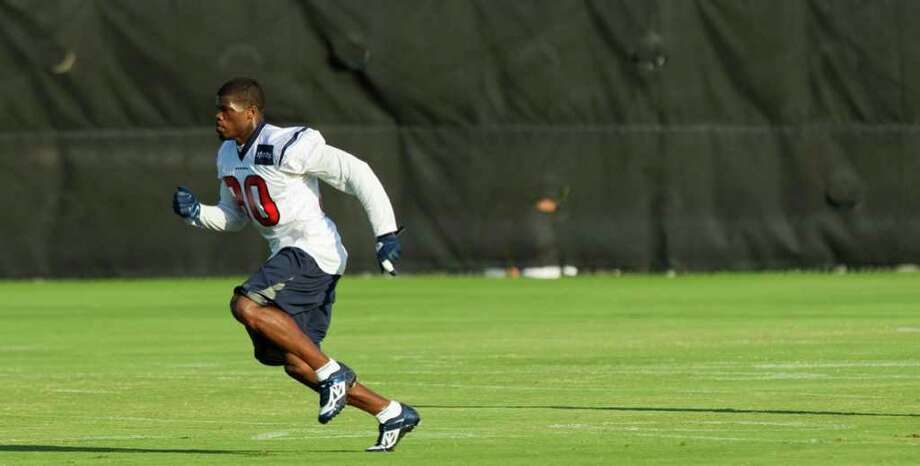 Houston Texans wide receiver Andre Johnson runs on the side while recovering from a dislocated finger during an NFL football training camp Saturday, Aug. 6, 2011, in Houston. Photo: Brett Coomer/Houston Chronicle / © 2010 Houston Chronicle