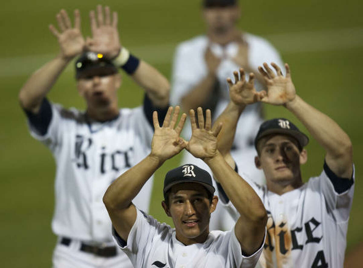 Rice players Daniel Gonzales-Luna, front, Steven Sutzbaugh, left, and Chad Mozingo, right, hold up the Owls sign following Rice's 13-4 victory over Kansas State. With the win Rice advances to face LSU in the super regionals.