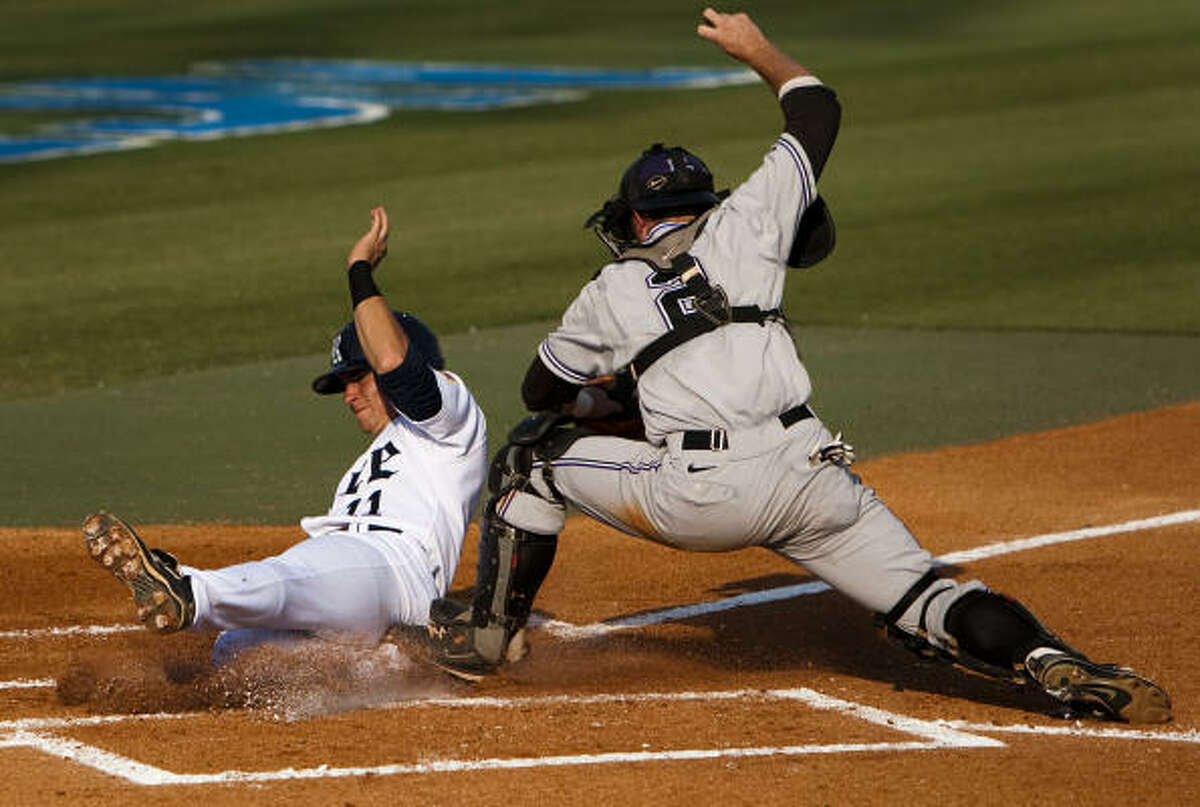 Rice shortstop Rick Hauge scores past the tag from Kansas State catcher Rob Vaughn during the first inning.