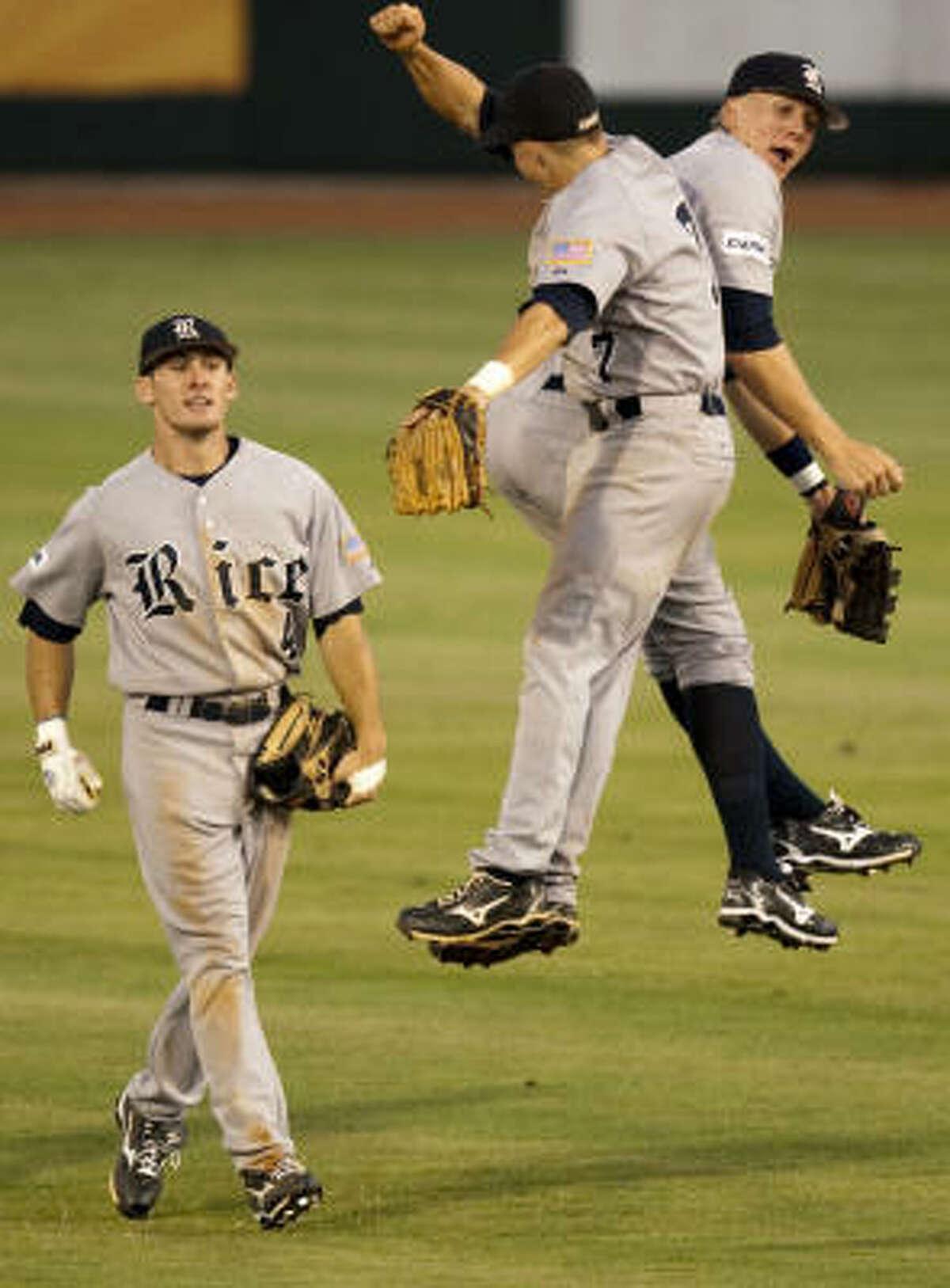 Rice 8, Kansas State 0 Rice center fielder Steven Sultzbaugh, right, celebrates with second baseman Brock Holt as right fielder Chad Mozingo looks on.