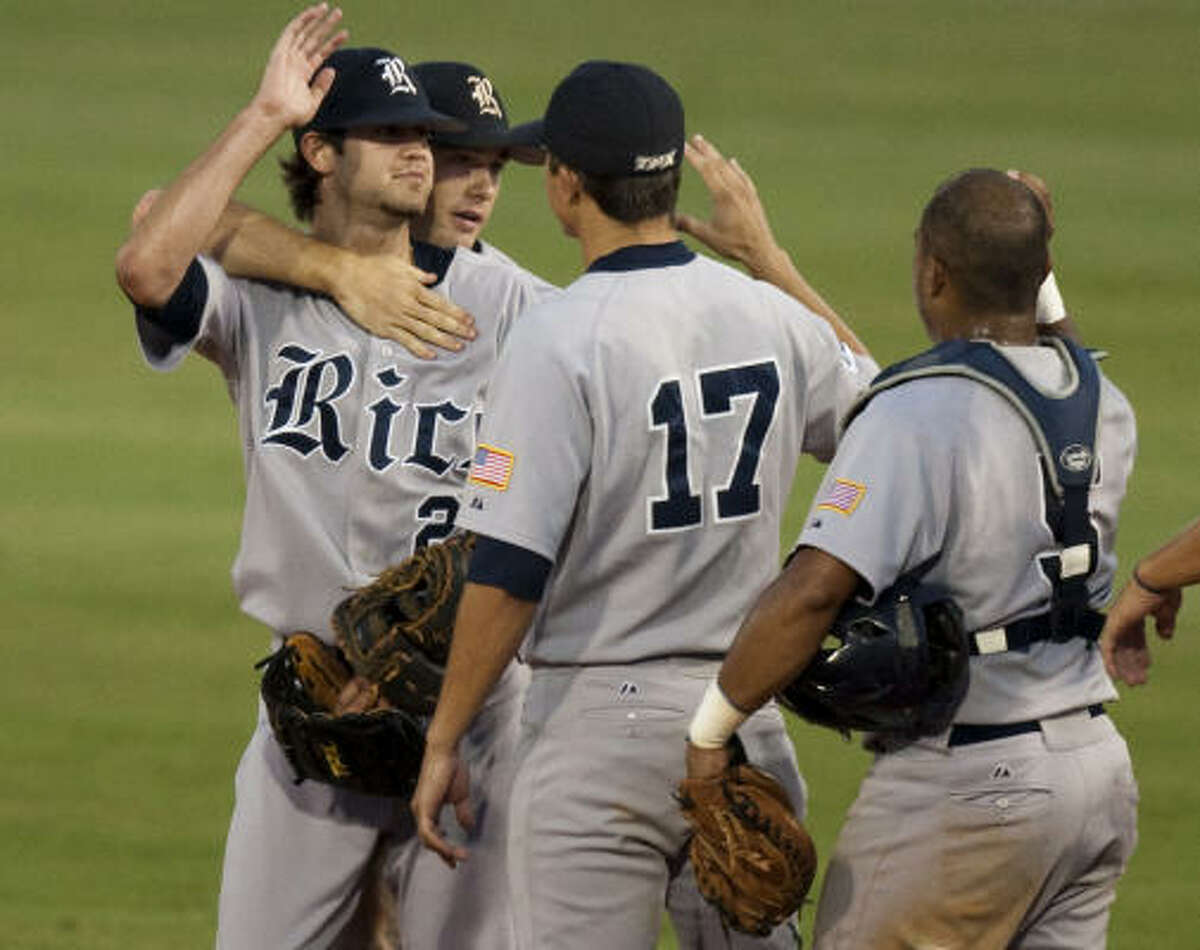 Rice 8, Kansas State 0 Rice pitcher Taylor Wall, left, celebrates with teammates after the final out.