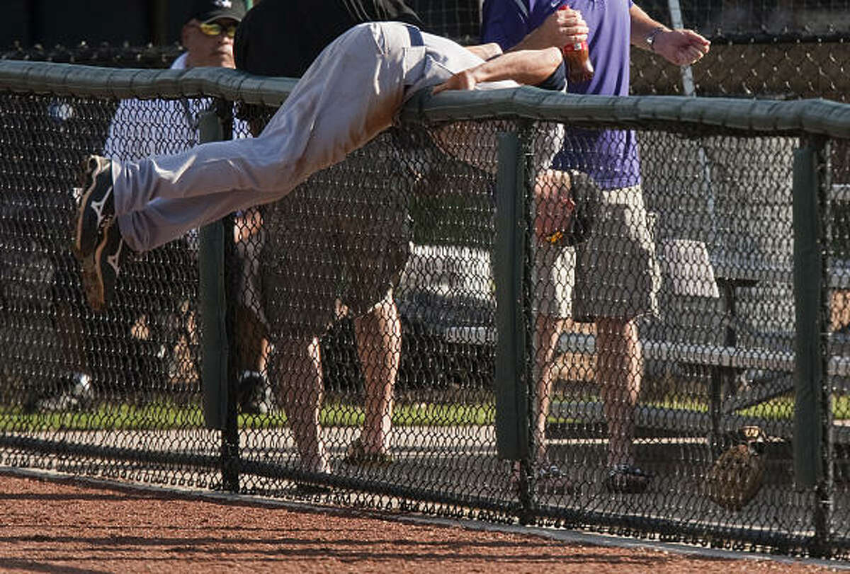 Rice 8, Kansas State 0 Rice second baseman Brock Holt tumbles over a railing while chasing a foul ball during the first inning.