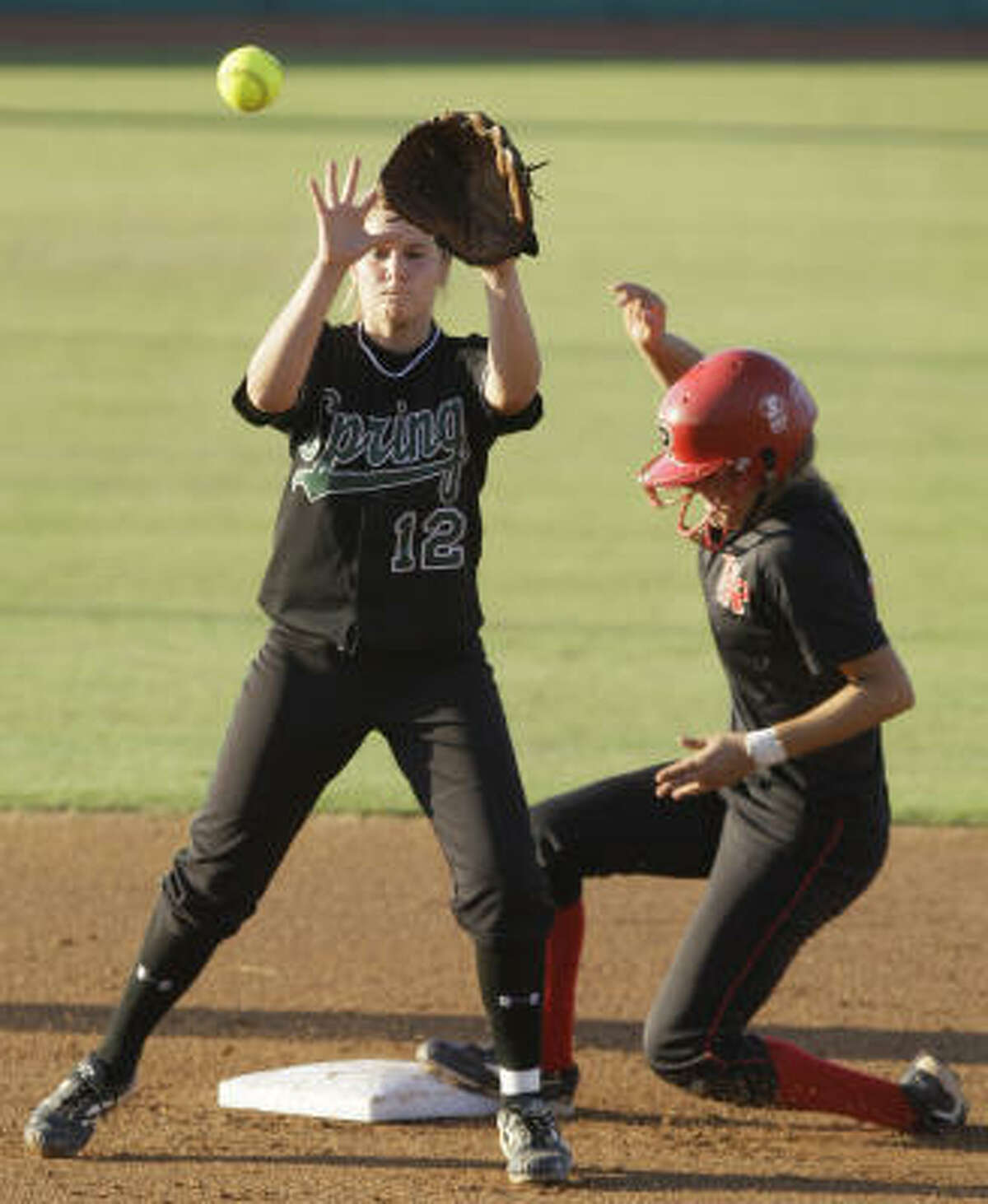 Vista Ridge's Corlee Ramirez slides into second base to beat the tag from Spring's Savannah Smith in the first inning of the 5A Region II softball final Thursday in College Station.