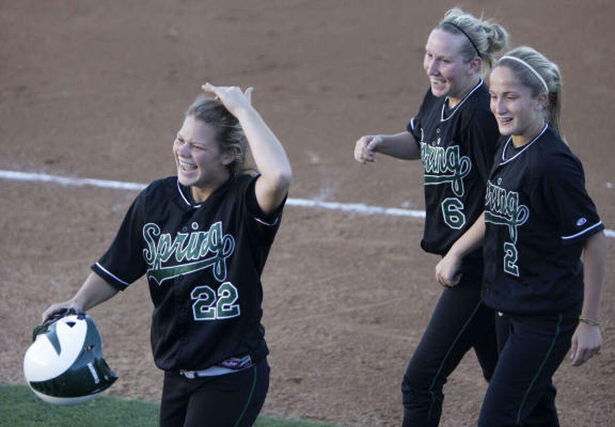 Spring's Tessa Galloway (22) celebrates her third-inning home run with teammates Katie Livanec (6) and Chelsea Burk (2) against Vista Ridge on Thursday.