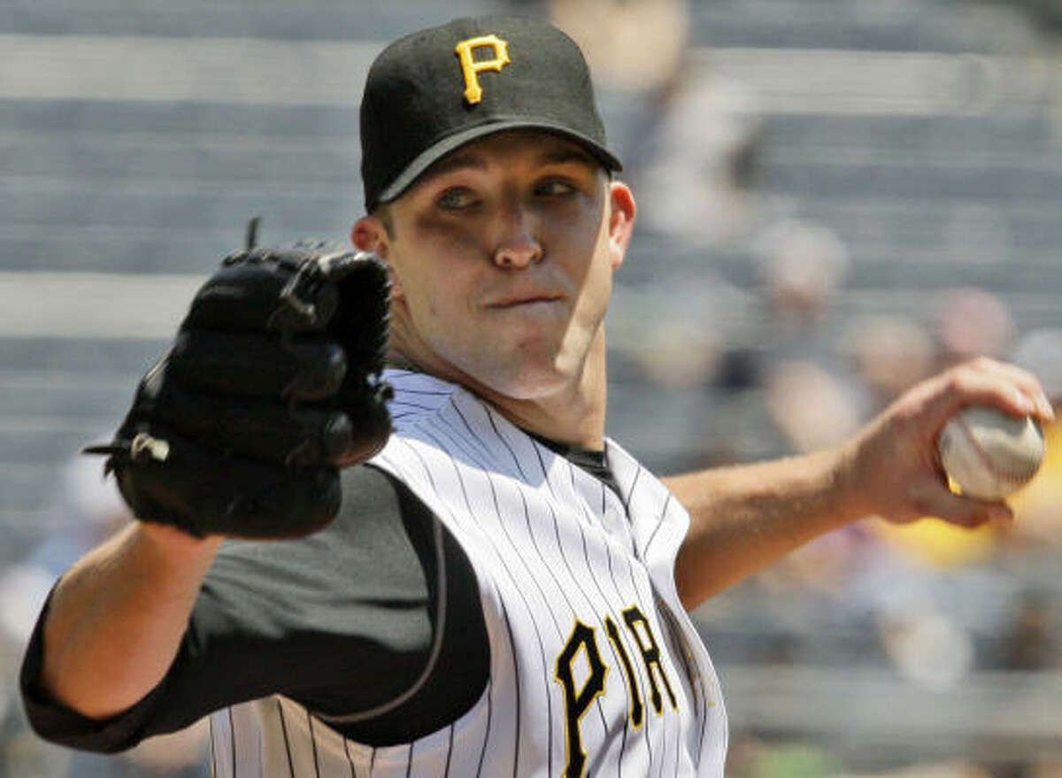 Pirates lefty Paul Maholm nearly matched Hampton, allowing two runs in his seven innings.