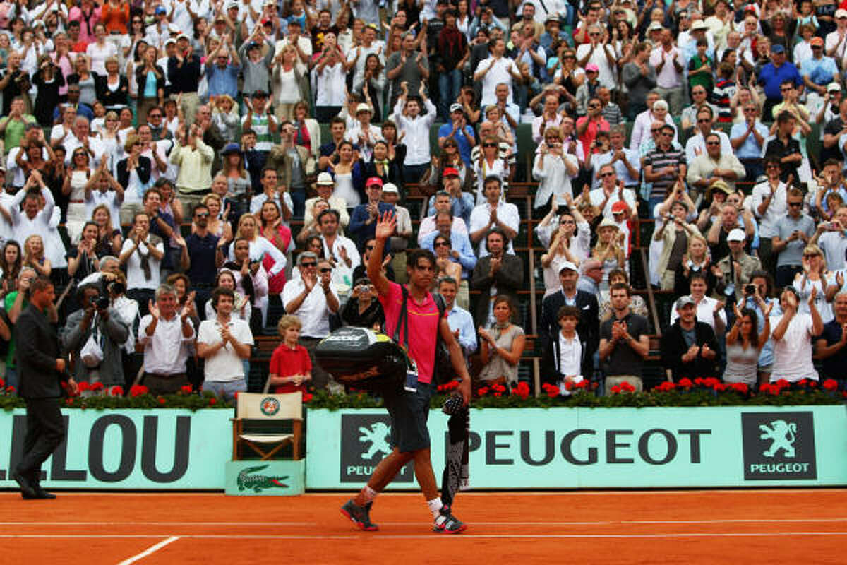 Rafael Nadal walks off the court following his loss to Robin Soderling in the fourth round of the French Open.