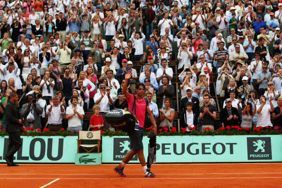 Rafael Nadal walks off the court following his loss to Robin Soderling in the fourth round of the French Open. Photo: Ryan Pierse, Getty Images