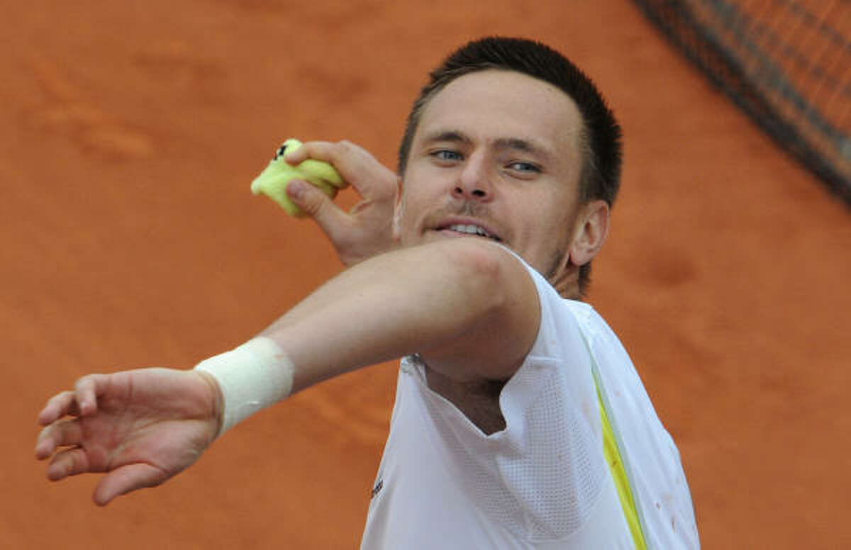 Robin Soderling throws his sweat band after beating four-time champion Rafael Nadal in the fourth round.