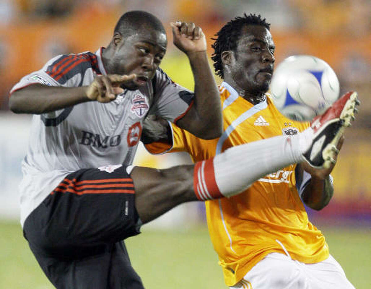 Toronto's Nana Attakora, left, plays the ball in front of Houston's Ade Akinbiyi.