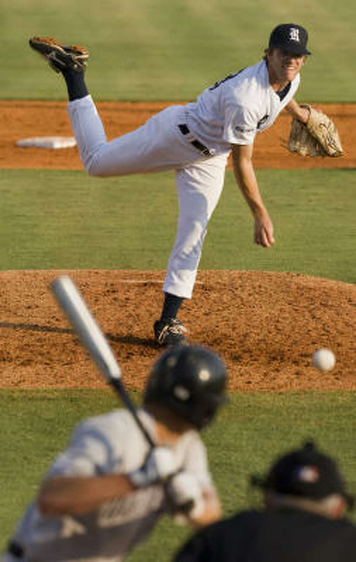 Rice pitcher Ryan Berry delivers a pitch during the third inning.
