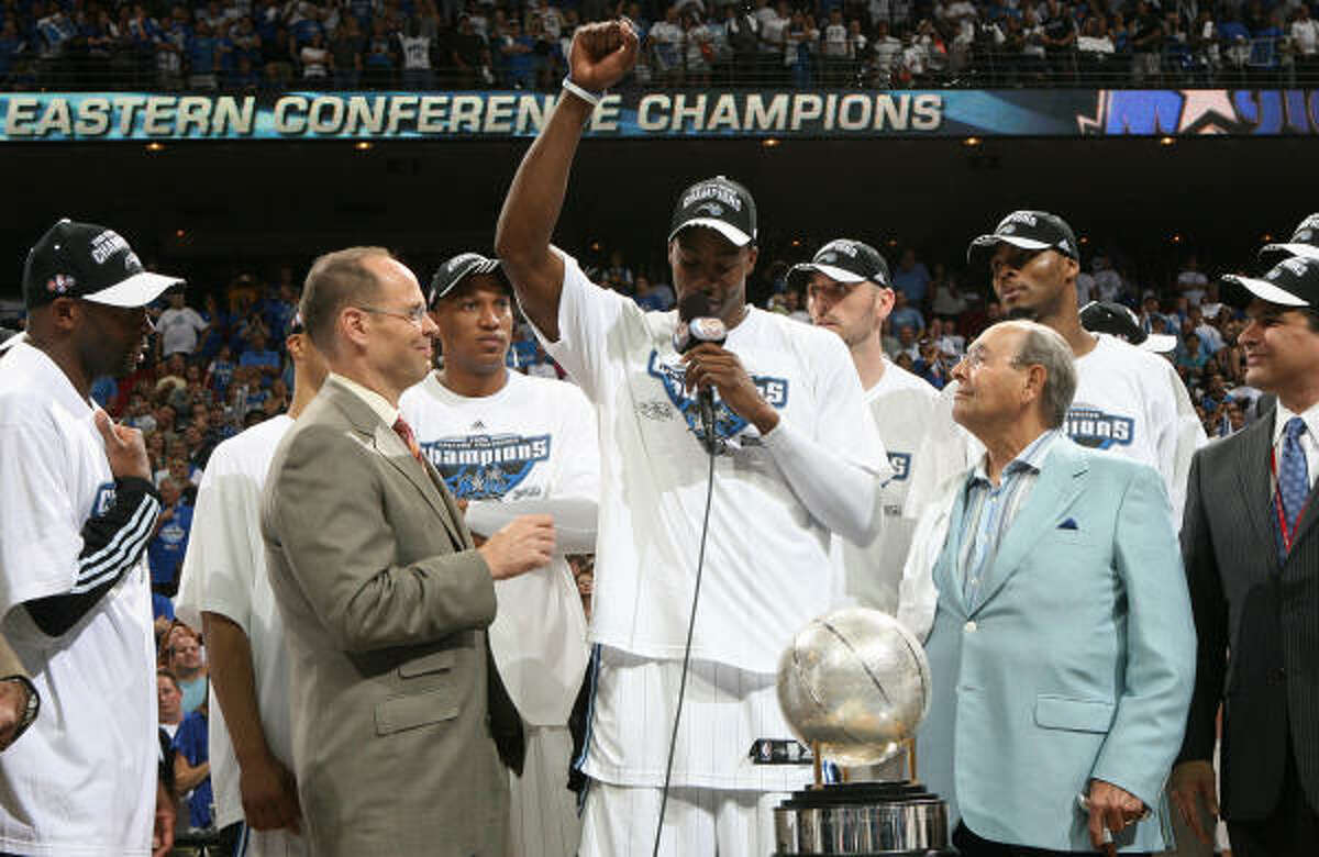 Game 6: Magic 103, Cavaliers 90 Orlando Magic center Dwight Howard, center, thanks God while standing next to owner Rich DeVos, right,and after defeating the Cleveland Cavaliers, 103-90, in Game 6 of the Eastern Conference Finals.