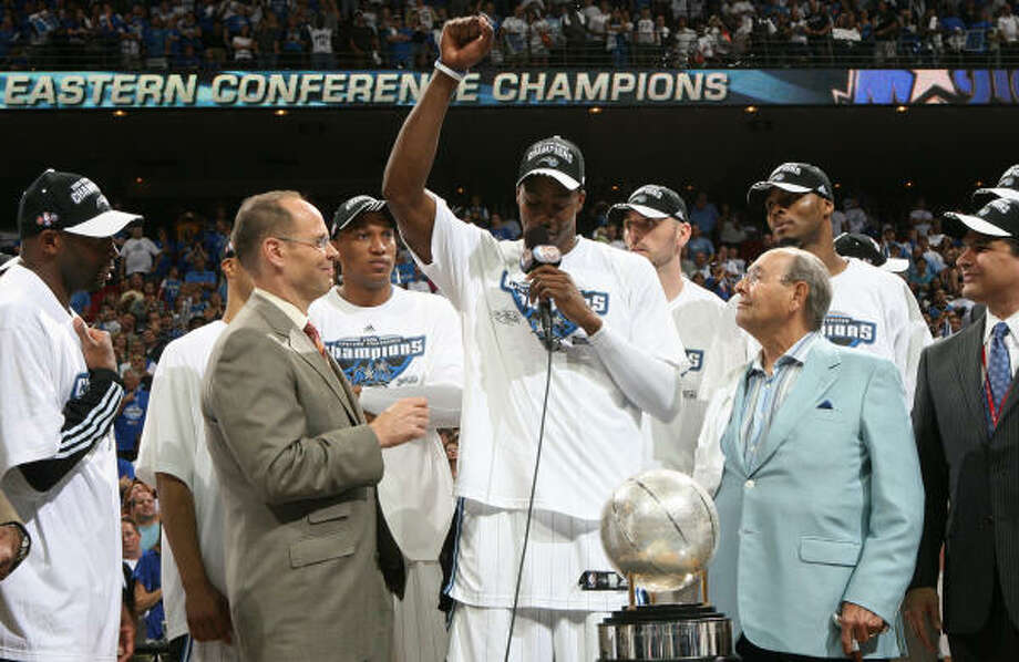 Game 6:  Magic 103, Cavaliers 90Orlando Magic center Dwight Howard, center, thanks God while standing next to owner Rich DeVos, right,and after defeating the Cleveland Cavaliers, 103-90, in Game 6 of the Eastern Conference Finals. Photo: Gary W. Green, MCT