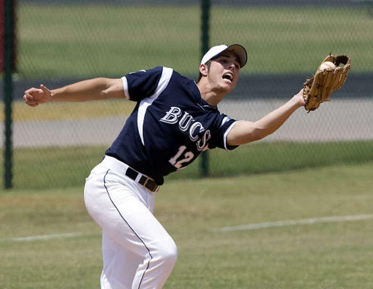 Brazoswood third baseman Ben Coram grabs a pop fly.