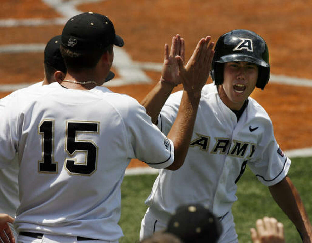 May 30: Army 7, Texas State 4 Army's David Darnell celebrates with teammates after scoring during the eighth inning.