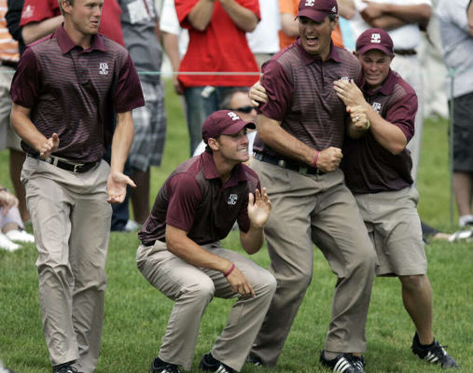 Members of the Texas A&M's golf team celebrate near the 18th green. It marks the Aggies' first team title since the women's softball team in 1987. Photo: J.D. Pooley, AP