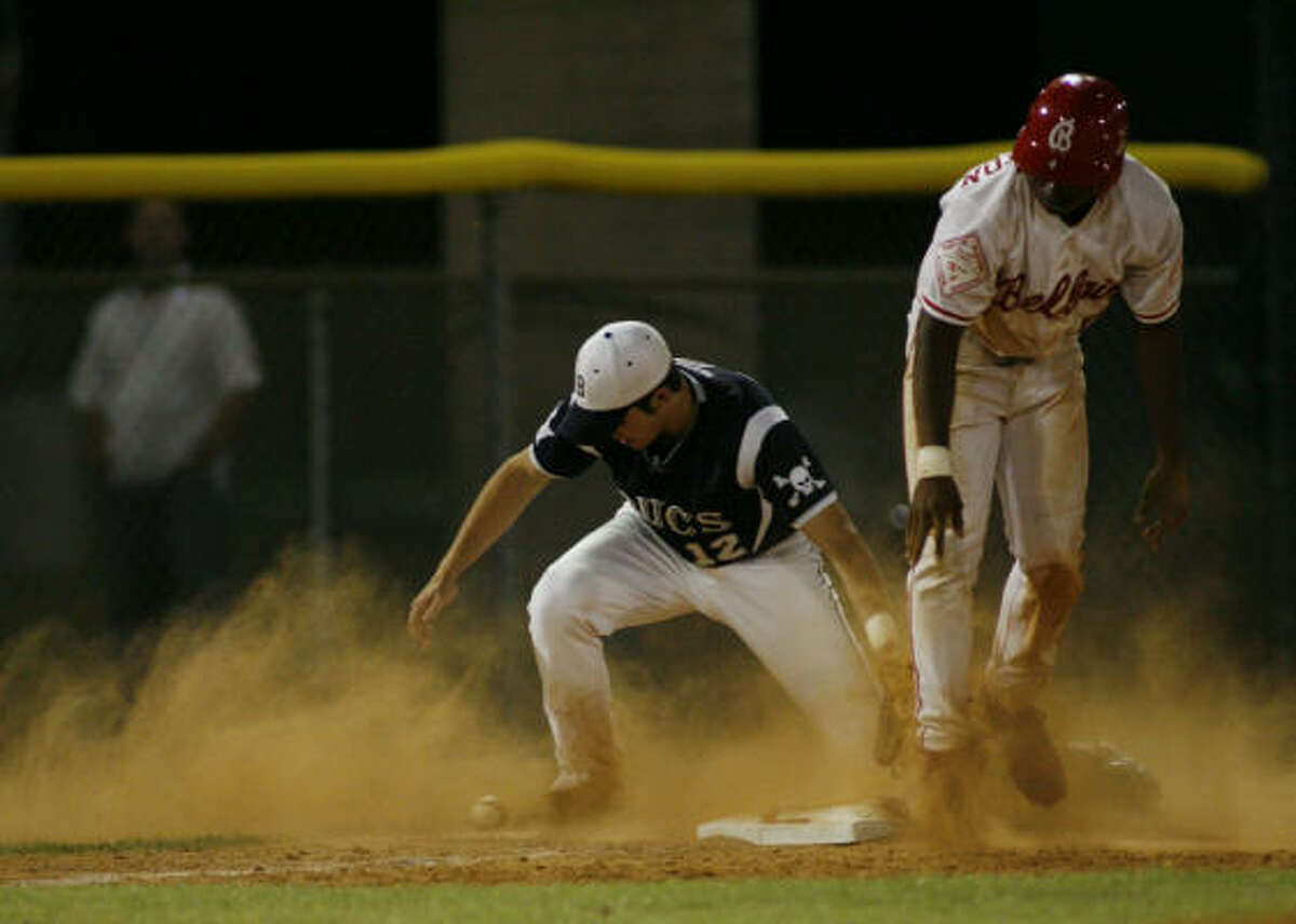 Bellaire's Sean Washington, right, steals third in the bottom of the third inning against Brazoswood.
