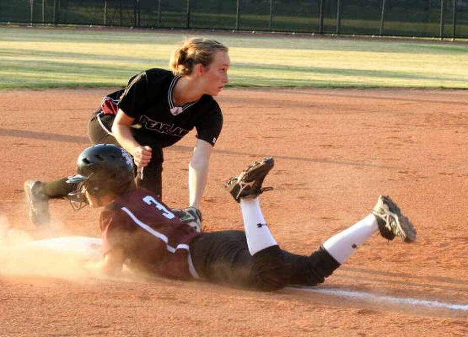 Clear Creek's Kadie Meadows slides into third after bringing in two runs. Photo: Gerald James, Chronicle