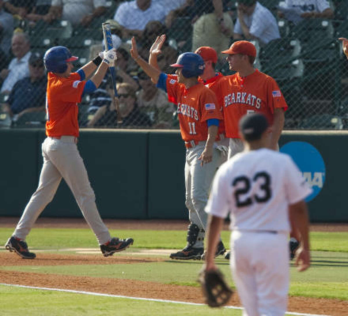 May 29: Rice 5, Sam Houston State 2 Sam Houston State players celebrate a first-inning home run by Ryan Mooney.