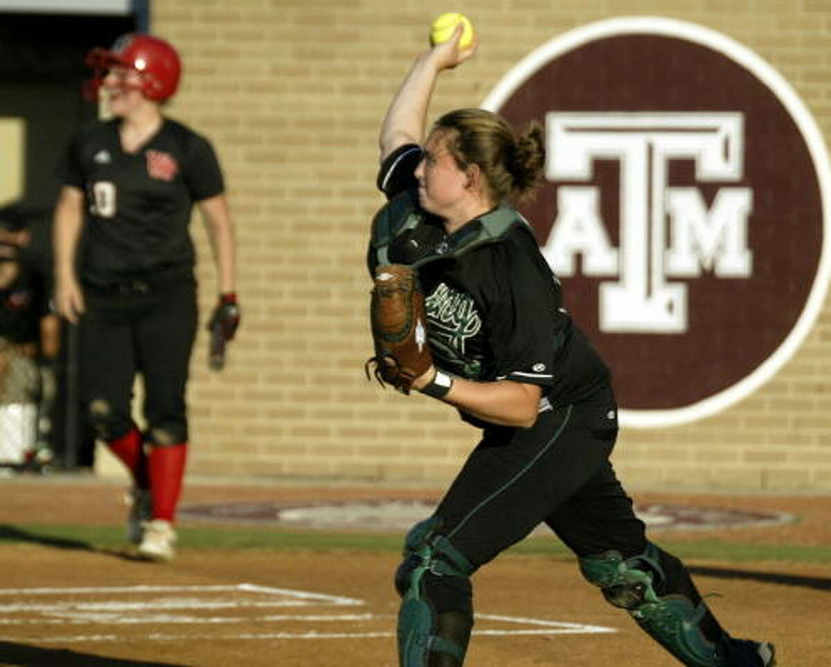 Catcher Megan Low tries to pick off a runner.