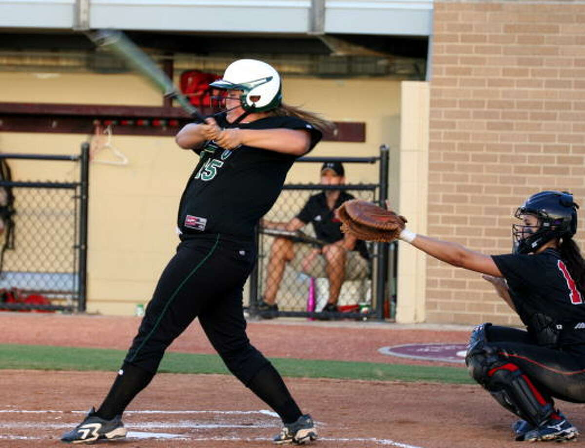 Dawn Martin makes contact for a hit.