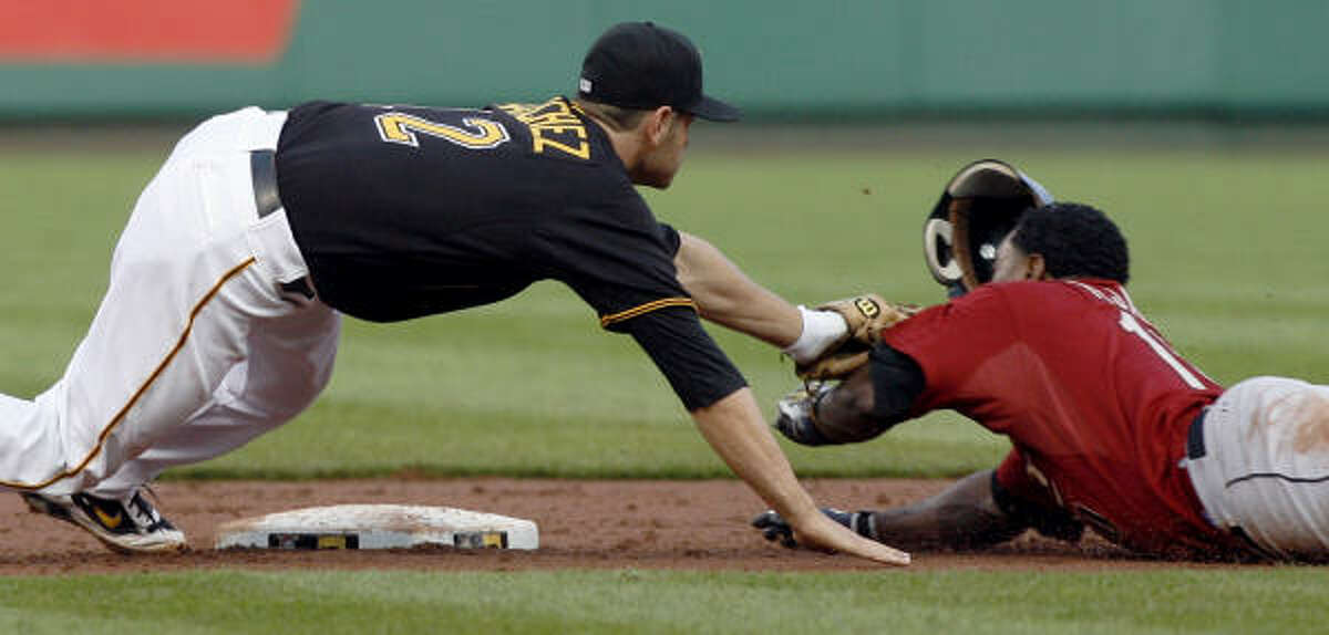 Houston's Miguel Tejada, right, is tagged out by Pirates second baseman Freddy Sanchez trying to stretch a base hit to a double in the third inning.