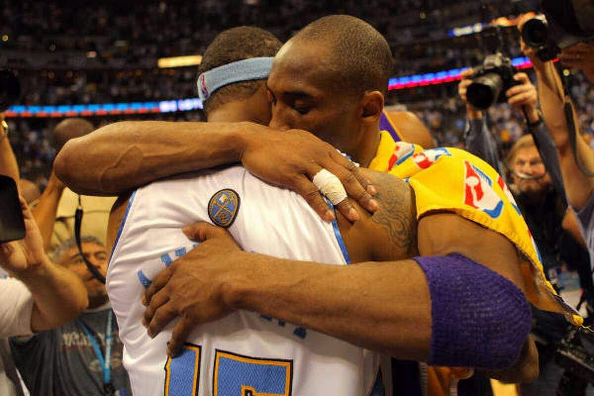 Game 6: Lakers 119, Nuggets 92 Friday, May 29: Kobe Bryant #24 of the Los Angeles Lakers hugs Carmelo Anthony #15 of the Denver Nuggets after the Lakers defeated the Nuggets 119-92 in Game Six of the Western Conference Finals.