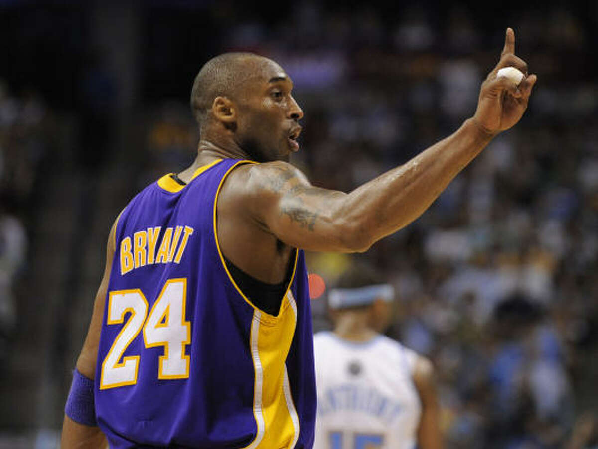 Game 6: Lakers 119, Nuggets 92 Los Angeles Lakers guard Kobe Bryant gestures toward the bench during the second half.