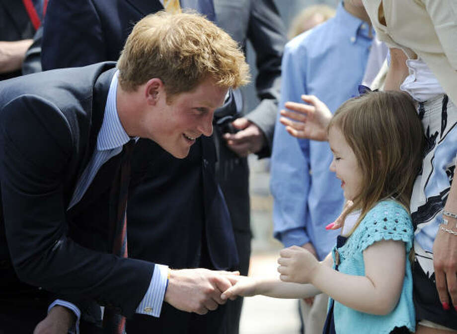 The 24-year-old, who's third in line to the British throne, greeted his American fans, including 4-year-old Madison Murphy, at the World Trade Center site. Photo: Stephen Chernin, Associated Press