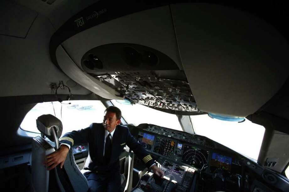 All Nippon Airways pilot Yoshio Taneda sits at the controls of the first Boeing 787 destined for use by launch customer All Nippon Airways. Photo: JOSHUA TRUJILLO / SEATTLEPI.COM