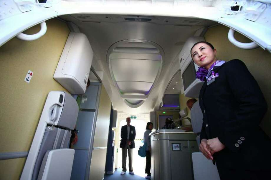 Flight attendant Kyoko Kouokawa waits at the door of the plane during the reveal of the first Boeing 787 destined for use by launch customer All Nippon Airways. Photo: JOSHUA TRUJILLO / SEATTLEPI.COM