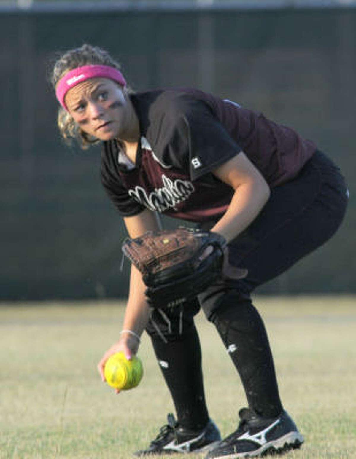Magnolia senior centerfielder Tara Kelehan picks up the hit that scored Waltrip's lone run.