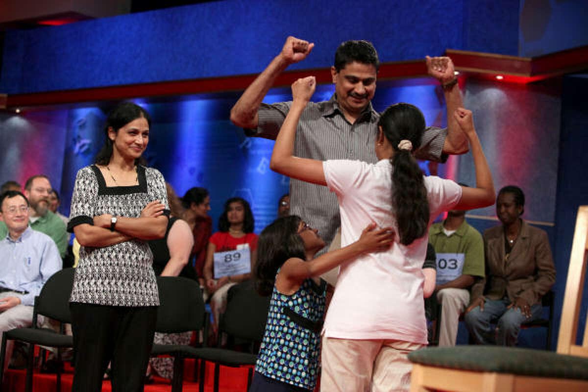 Kavya Shivashankar of Olathe, Kansas, celebrates with family after winning the 2009 Scripps National Spelling Bee competition.