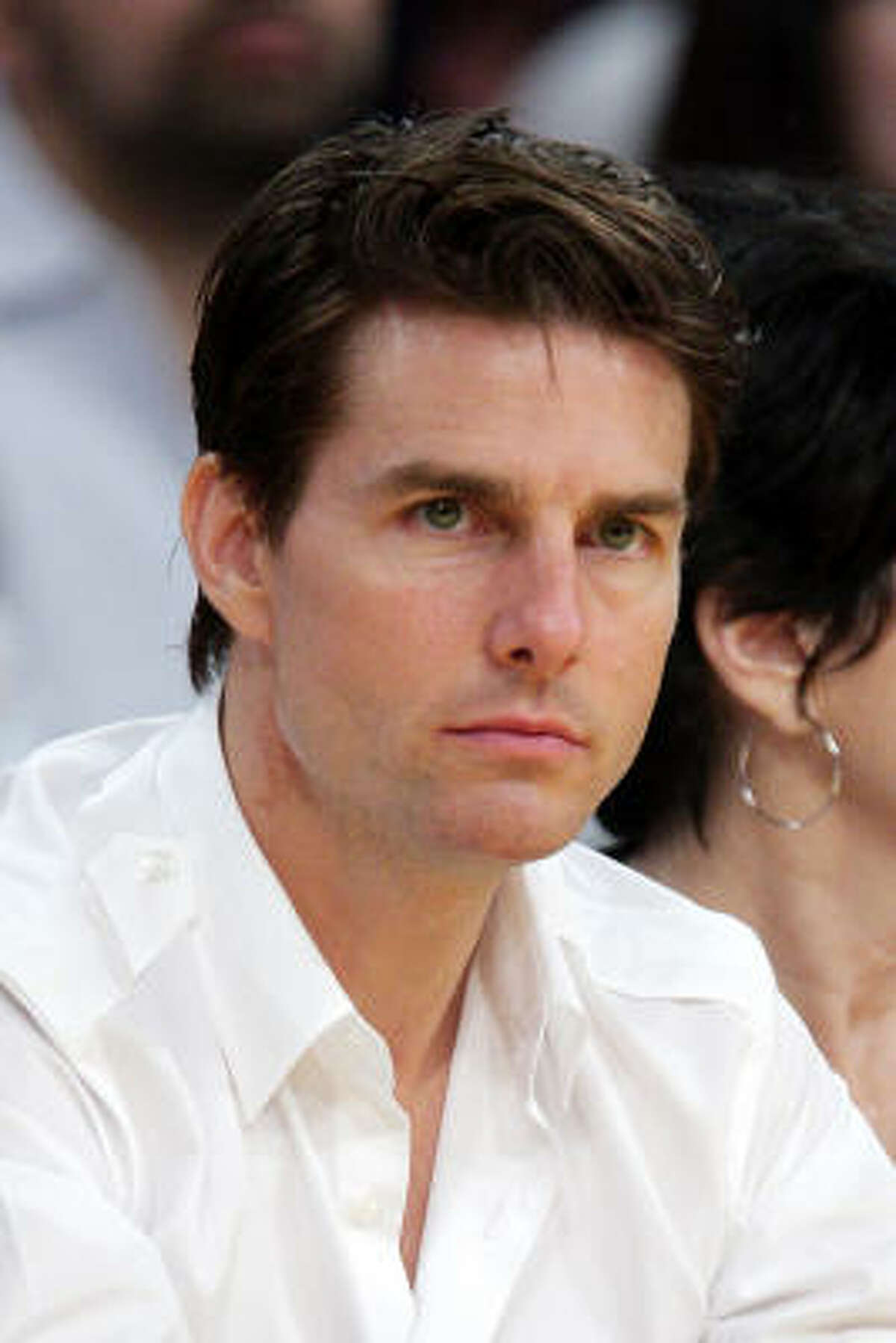 Tom Cruise has become the poster boy for Scientology. Andrew Morton, author of ``Tom Cruise: An Unauthorized Biography,'' alleges the actor ranks second in command in the Church of Scientology.