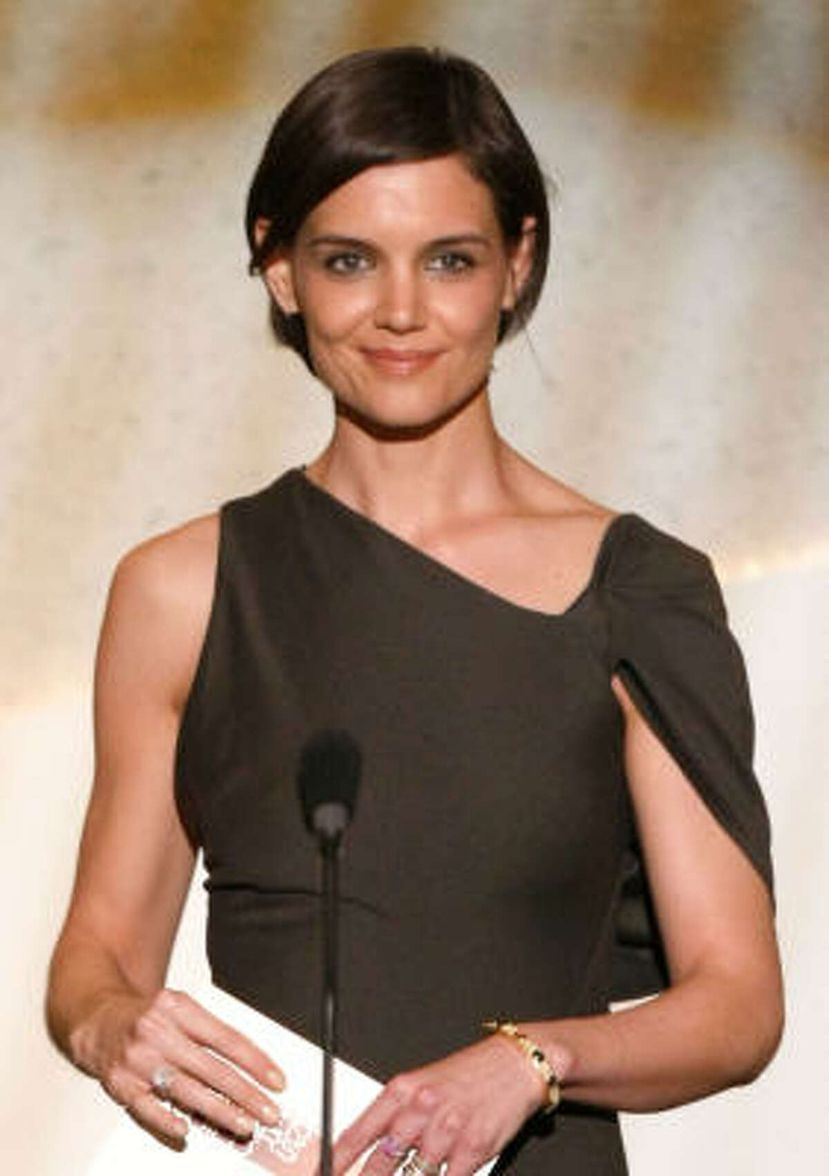 Actress Katie Holmes married Tom Cruise in an evening wedding performed by a Scientology minister.