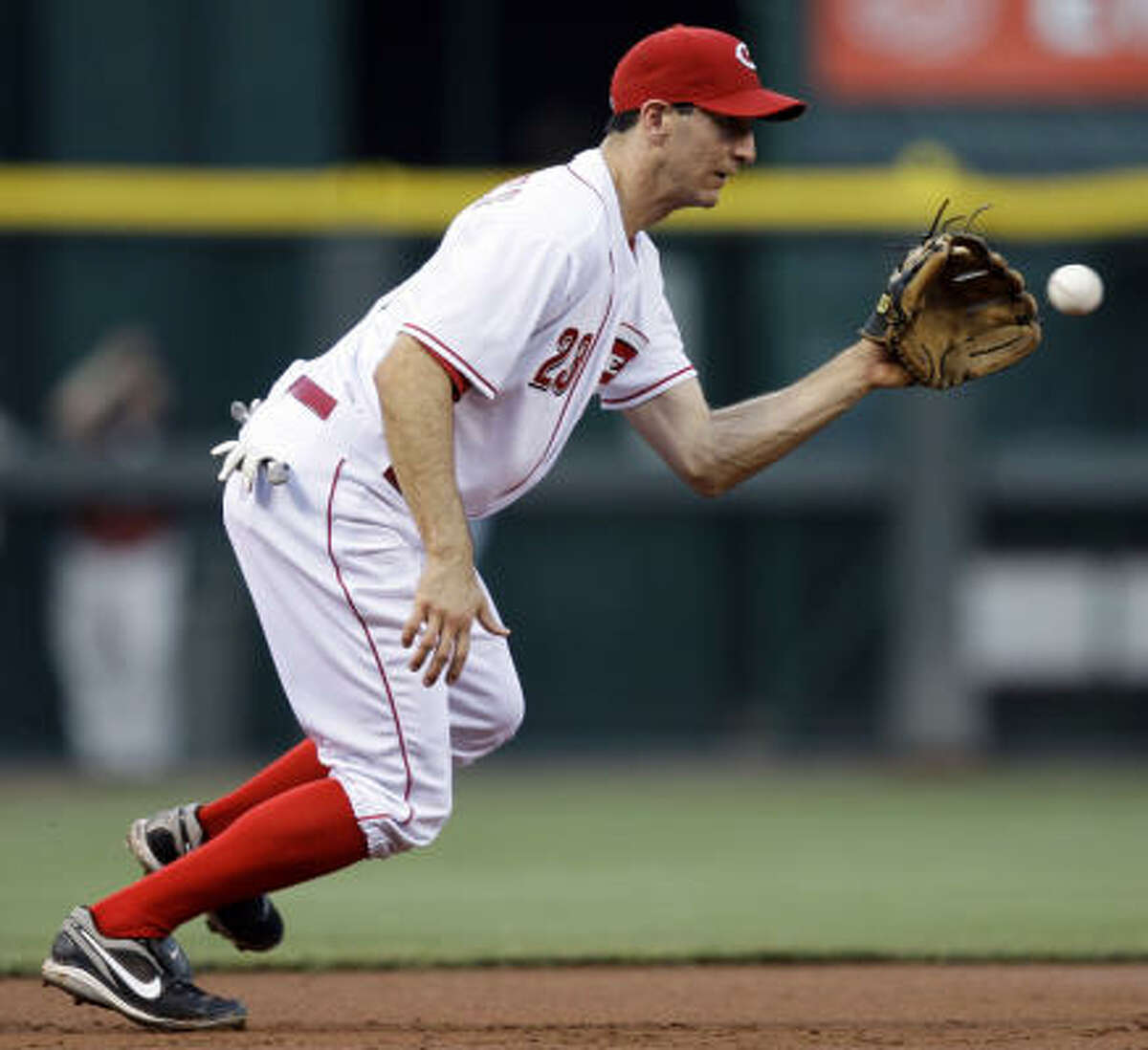 Reds third baseman Adam Rosales fields a ground ball hit by Houston's Roy Oswalt for an out in the third inning.