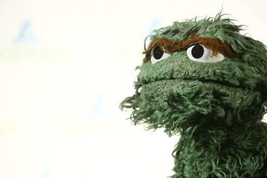 It takes a truly brave soul to show up among New York's most fashionable wearing Oscar the Grouch.  Photo: Getty Images