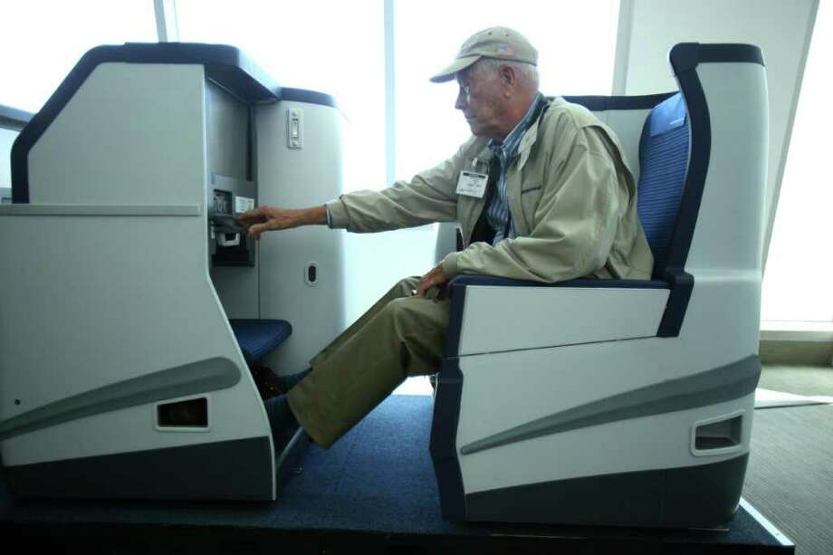 Ed Hirsch of International Aviation Magazine Group tests a mock-up of an international business class seat during the reveal of the first Boeing 787 destined for use by launch customer All Nippon Airways. Photo: JOSHUA TRUJILLO / SEATTLEPI.COM