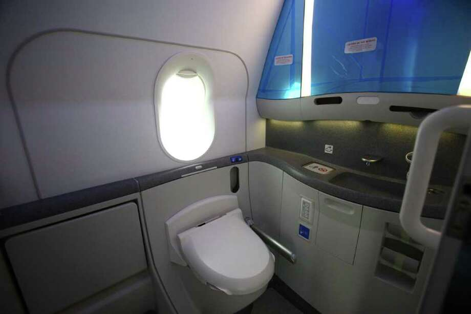The interior of a mid-cabin restroom is shown during the reveal of the first Boeing 787 destined for use by launch customer All Nippon Airways. The restroom includes a window over the toilet and a bidet. Photo: JOSHUA TRUJILLO / SEATTLEPI.COM
