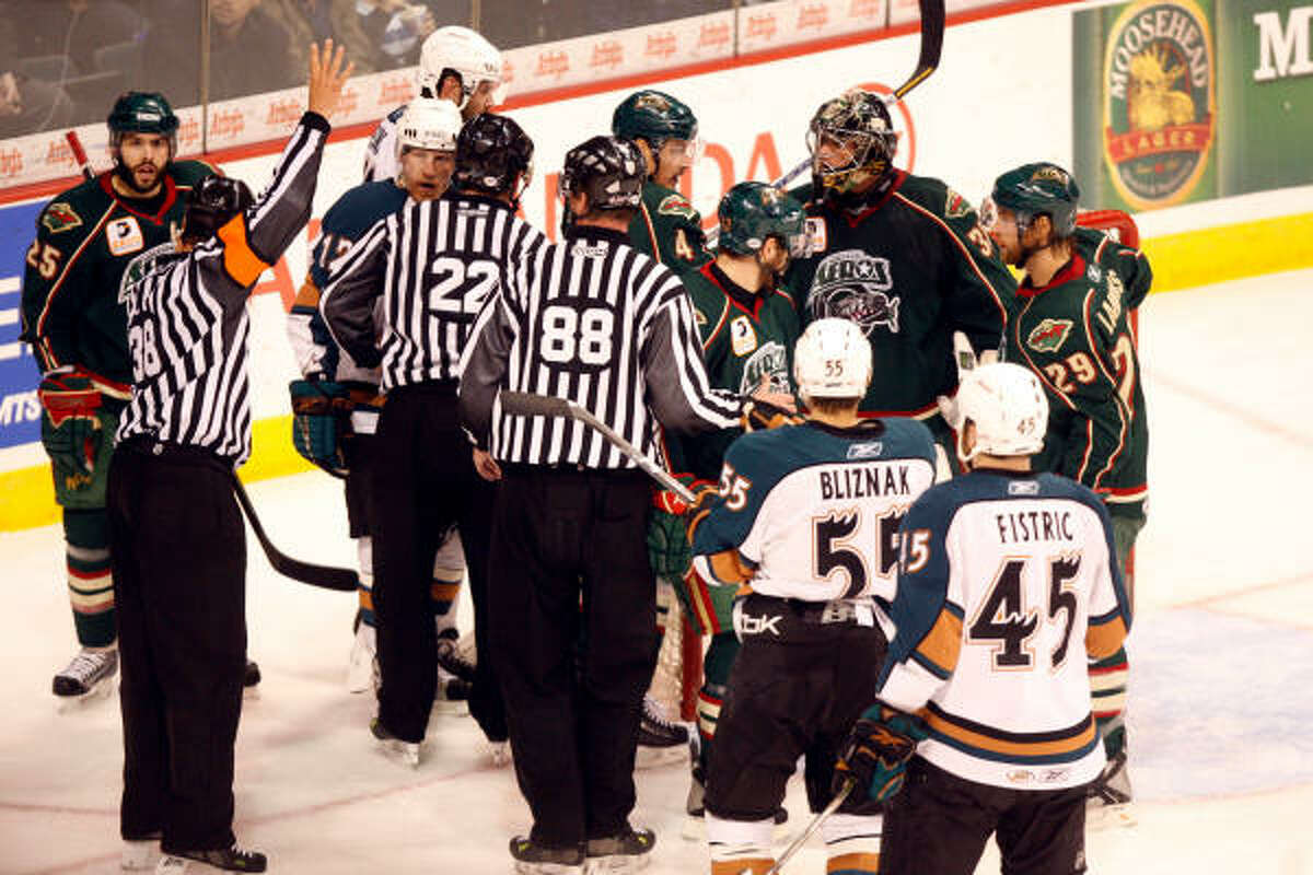 Referees break up an altercation between the Manitoba Moose and Houston Aeros at the MTS Centre.
