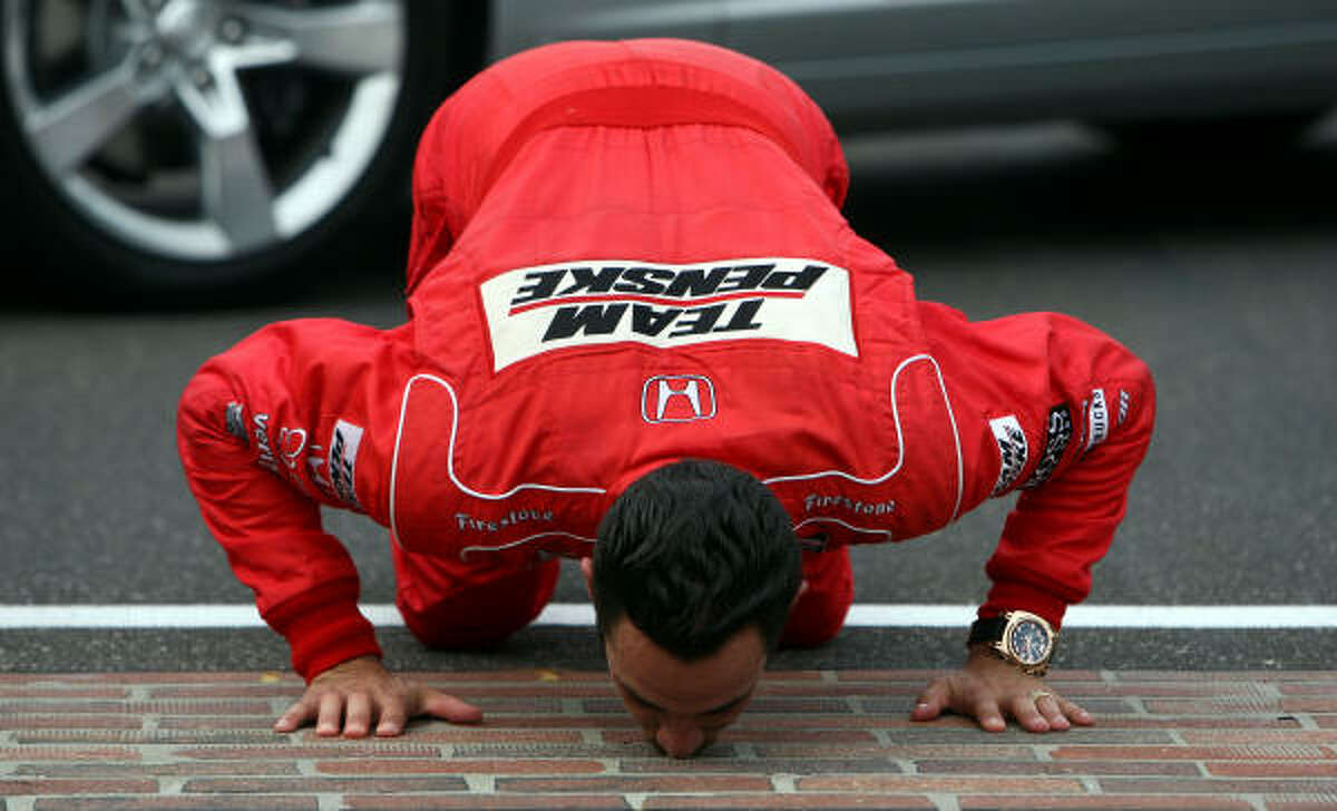Helio Castroneves, driver of the #3 Team Penske Dallara Honda, celebrates his victory by kissing the yard of bricks during the IRL IndyCar Series 93rd running of the Indianapolis 500.