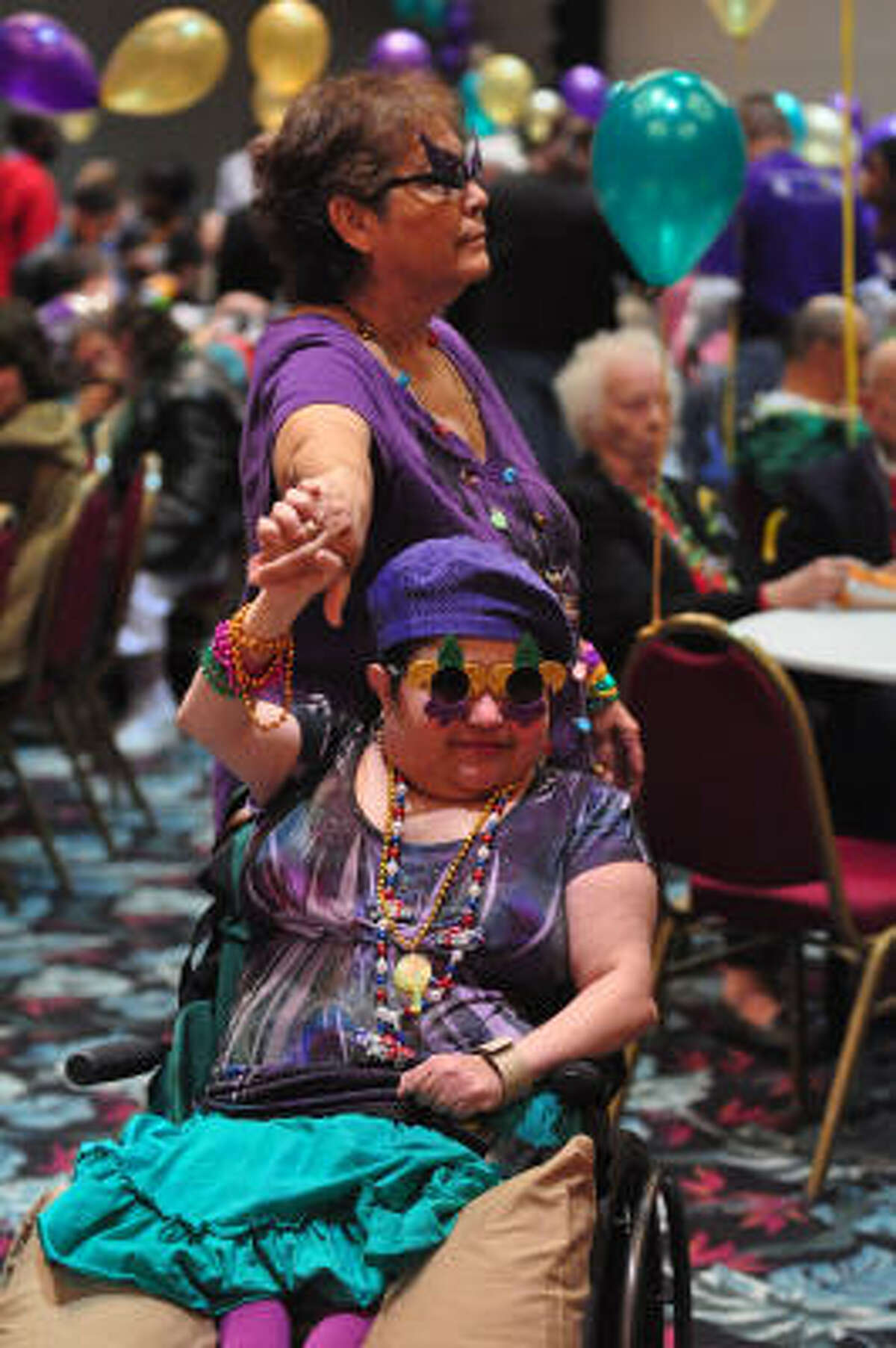 Moody;s Mardi Gras: Alma Sosa dances with her daughter, Mylena Perez.