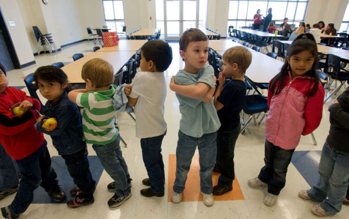 Students line up to return to class after lunch at Crenshaw Elementary and Middle School on Wednesday in Crystal Beach.