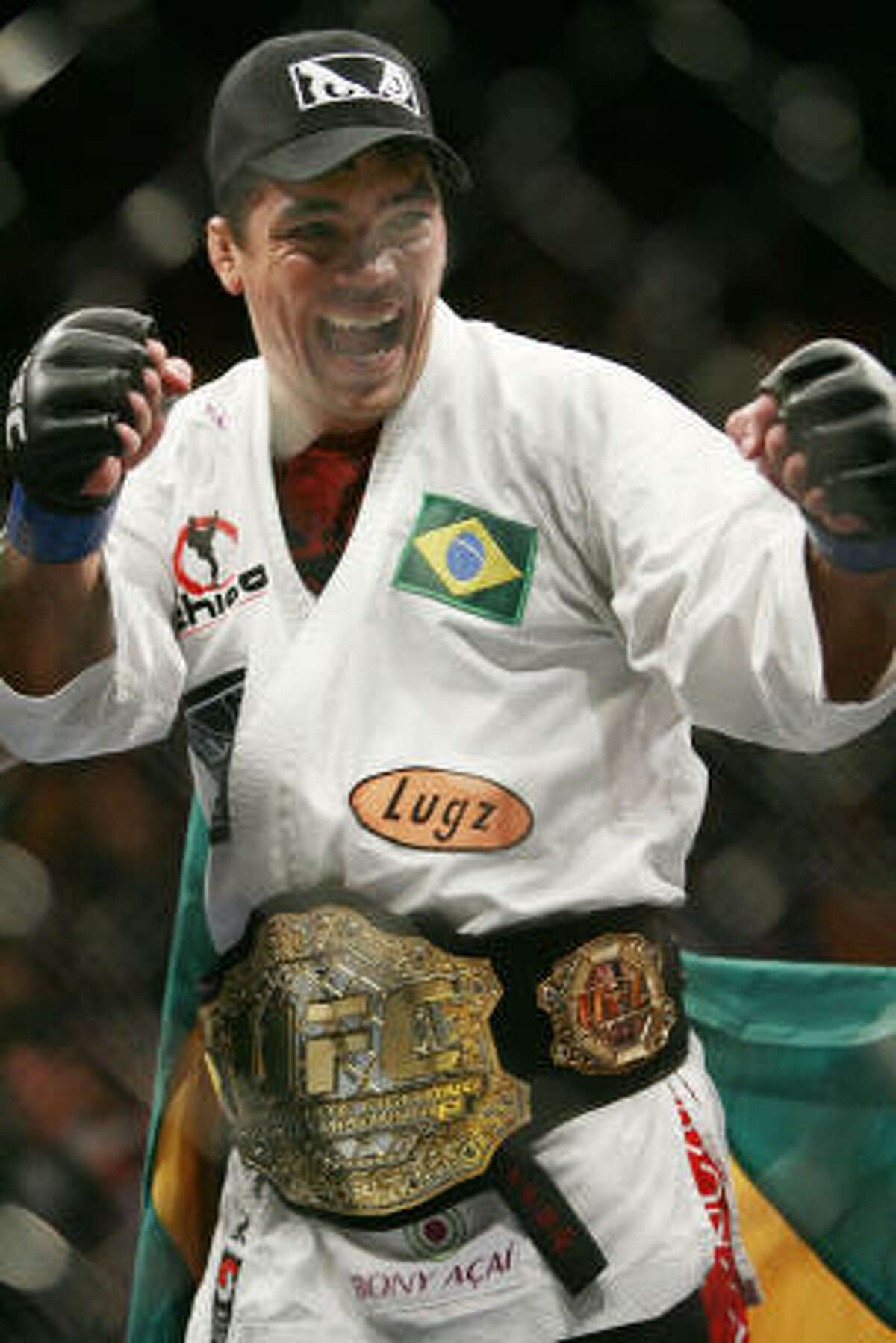 Lyoto Machida celebrates his second round knockout victory over Rashad Evans during their light heavyweight title fight.