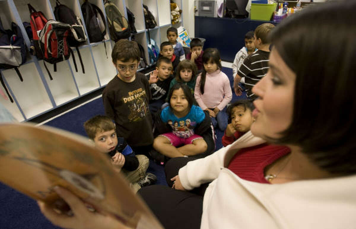 First- and second-grade teacher Melissa Senseney reads to her students at Crenshaw Elementary and Middle School Wednesday in Crystal Beach on the Bolivar Peninsula.